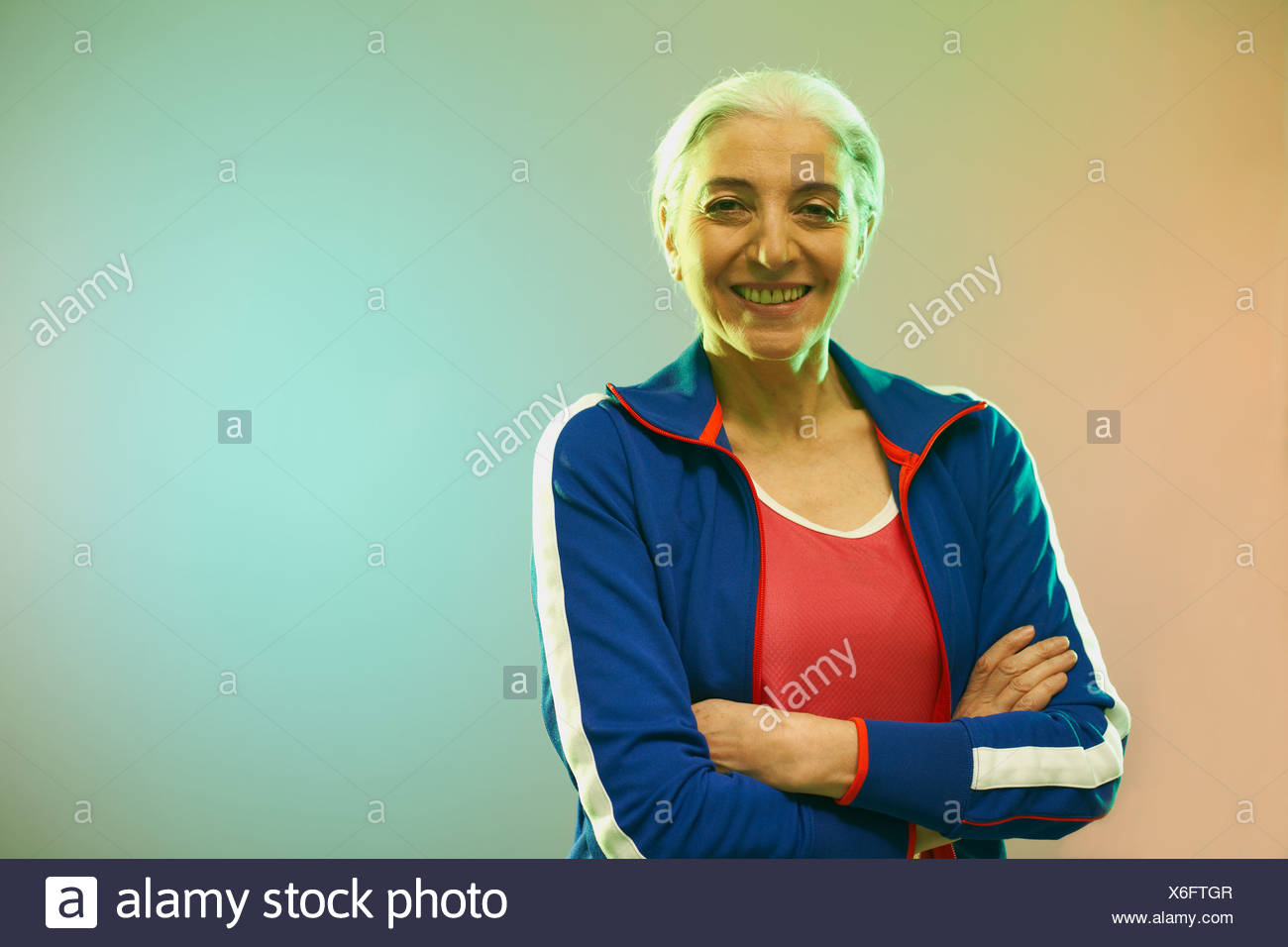 Mature woman wearing tracksuit top - Stock Image
