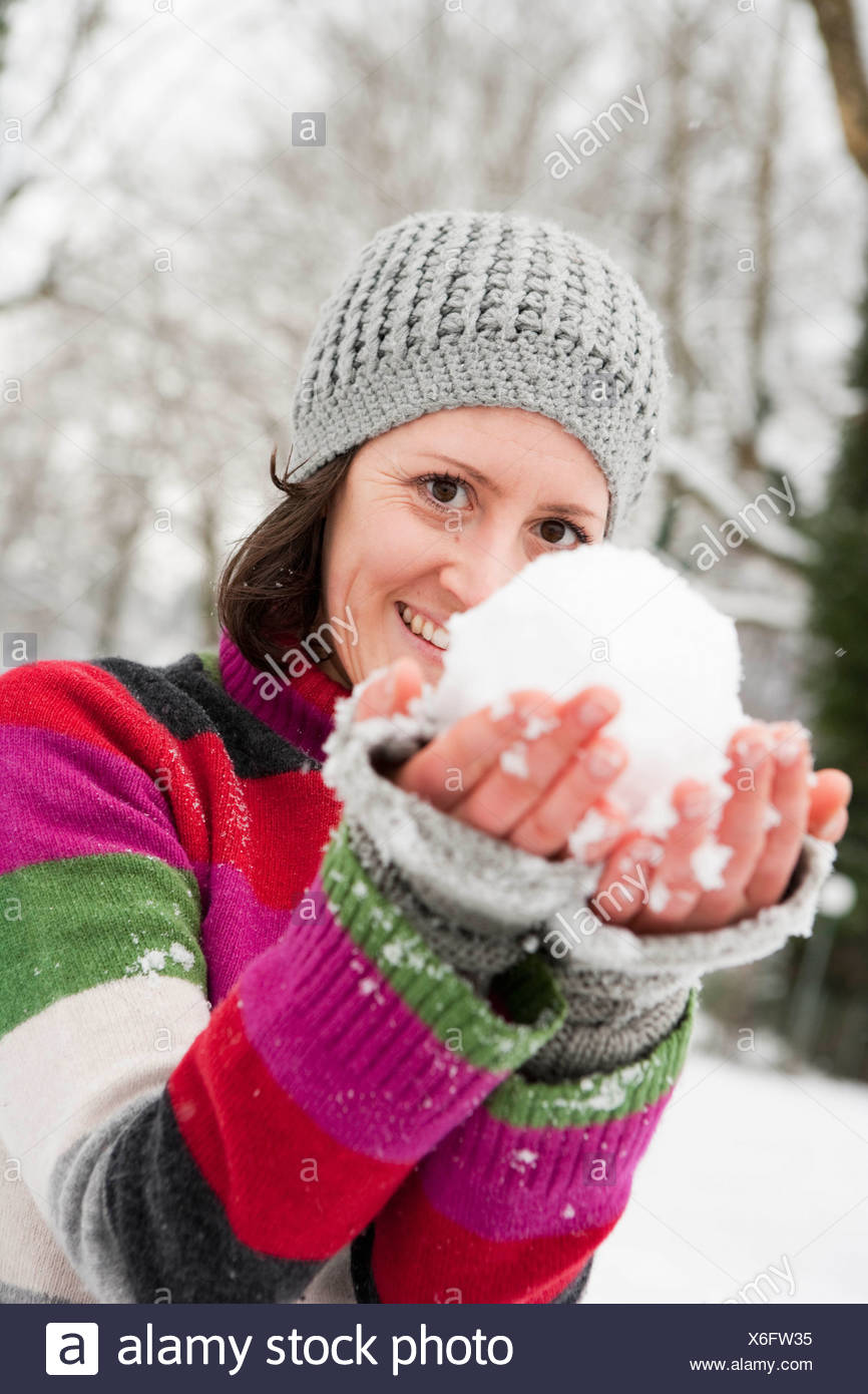 woman showing snowball - Stock Image
