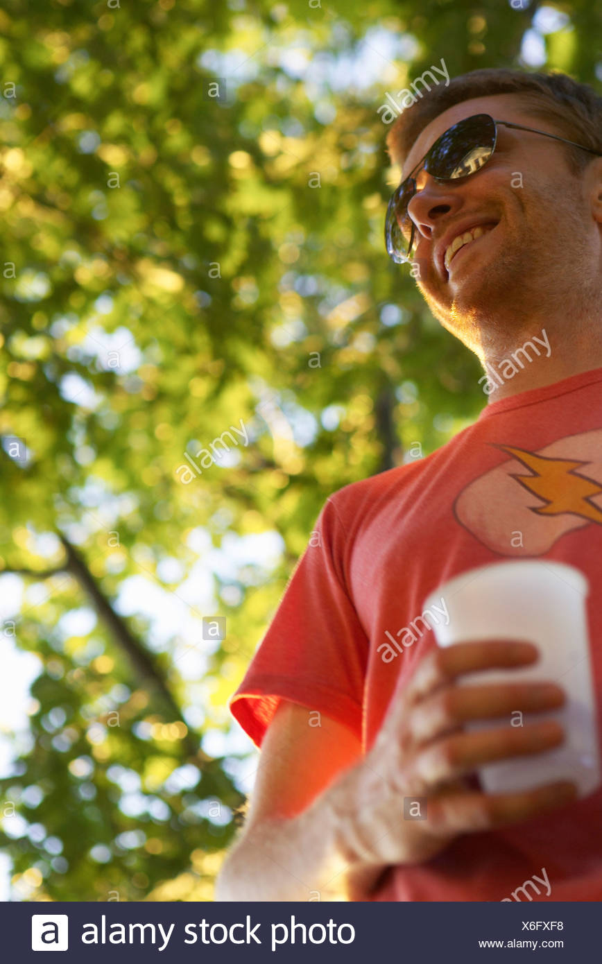 Man Holding Drink, Prince Edward County, Ontario - Stock Image