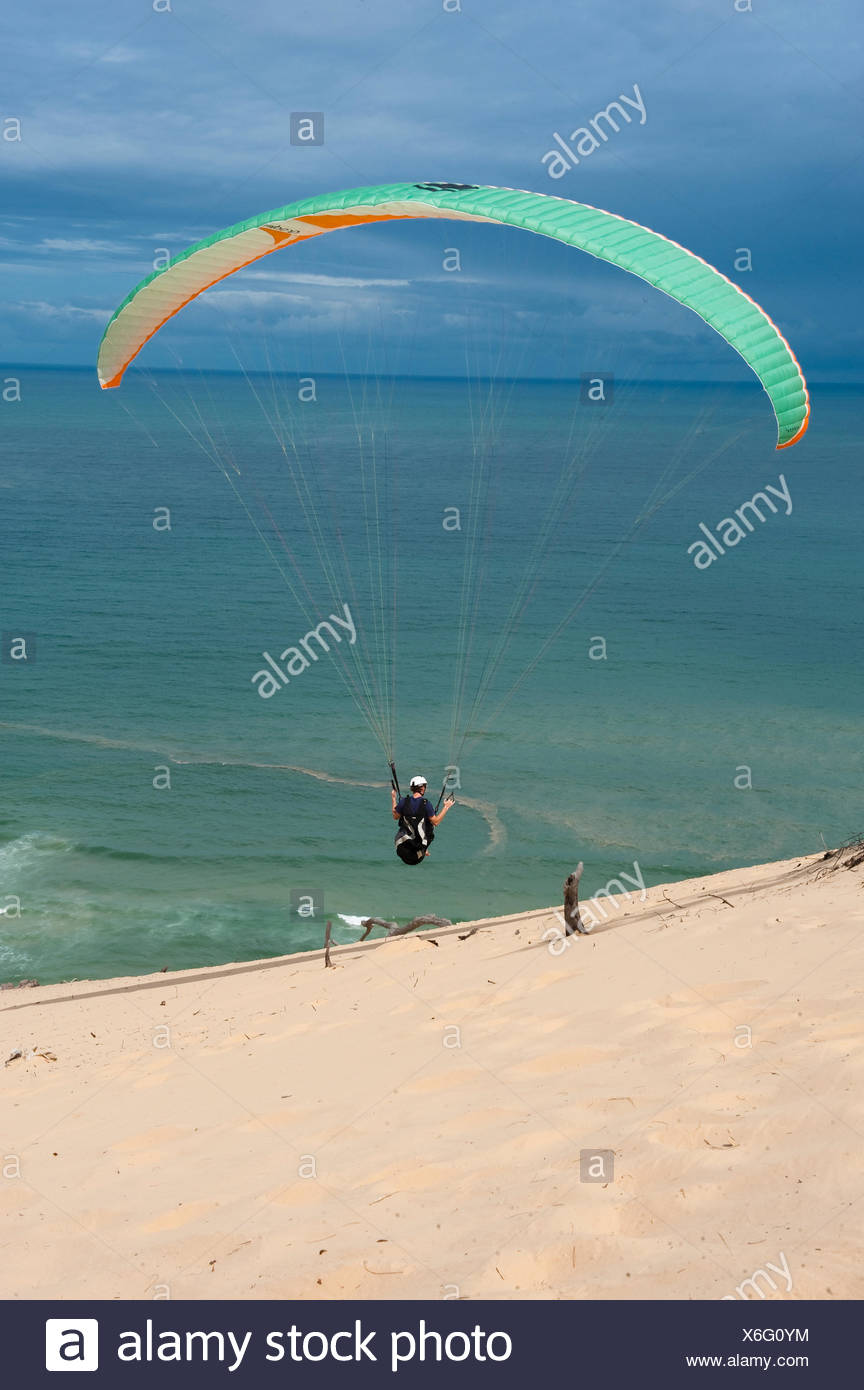 Paraglider on coast, Rainbow Beach, Queensland, East Coast, Australia - Stock Image