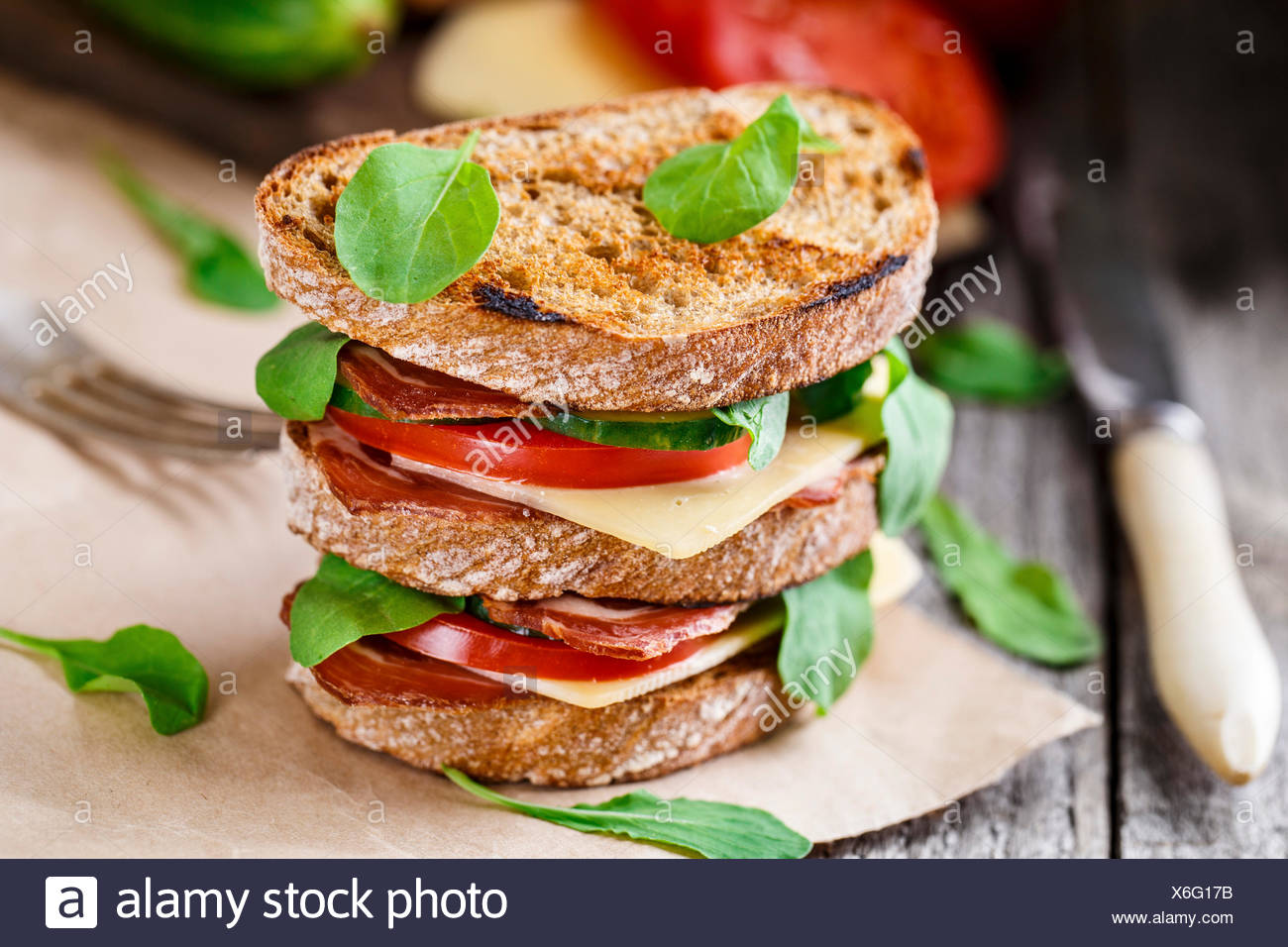 Big sandwich with ham, cheese and vegetables - Stock Image