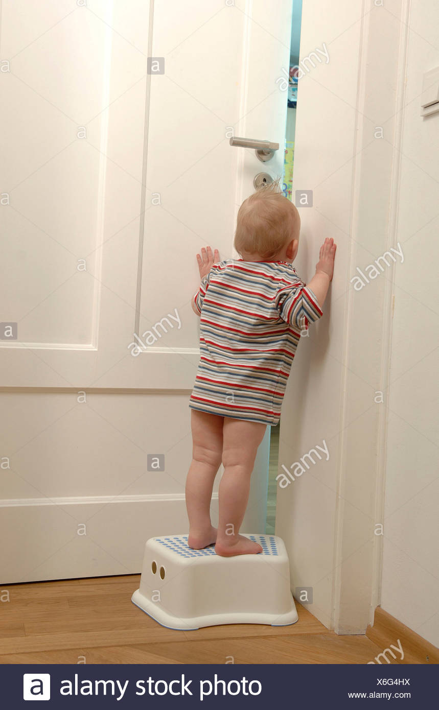 Fantastic Toddler Standing On A Stool Looking Through A Gap In The Theyellowbook Wood Chair Design Ideas Theyellowbookinfo