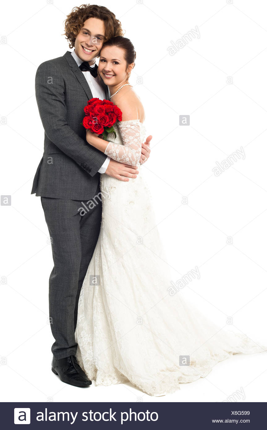 Lovely young married couple embracing warmly - Stock Image