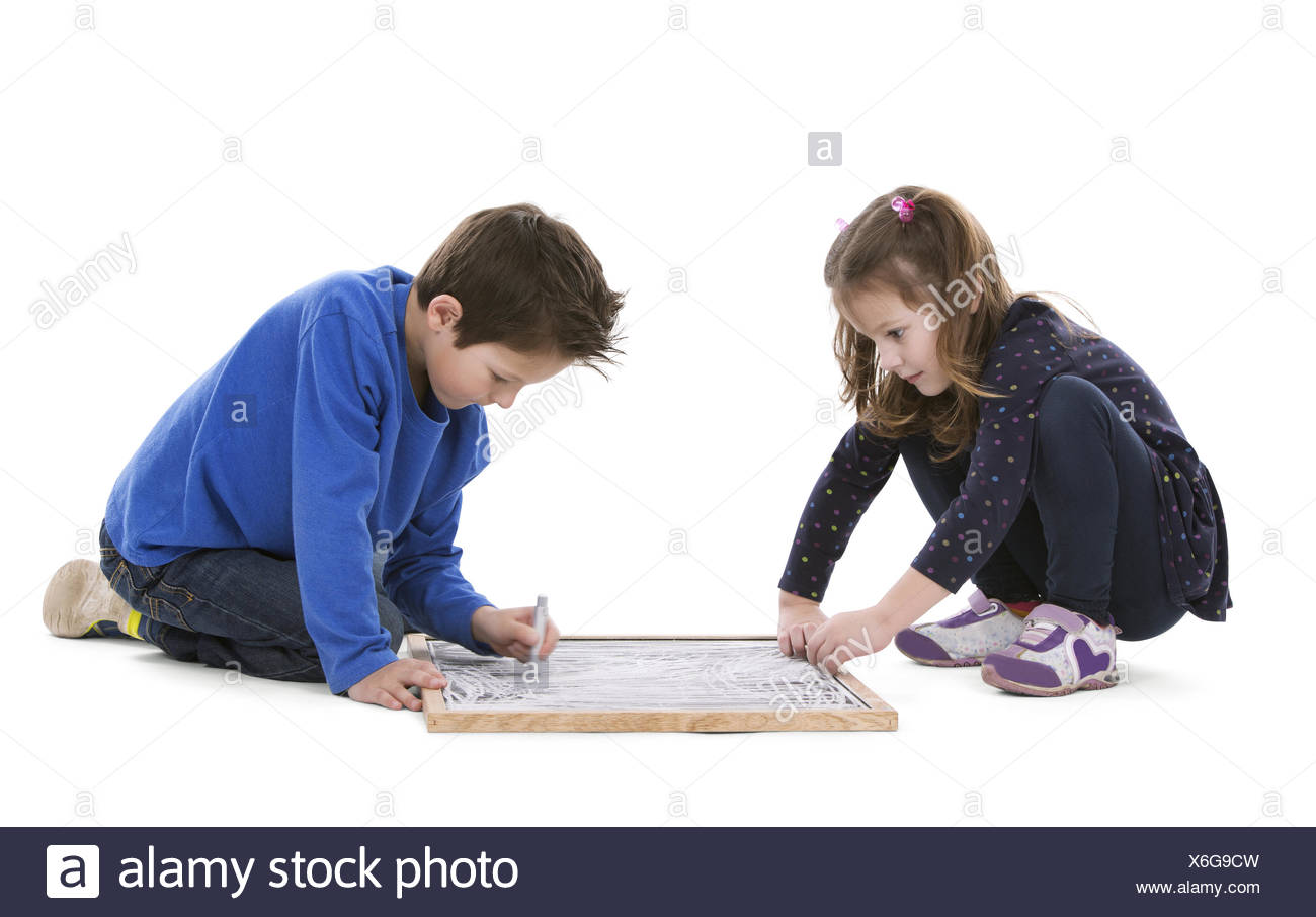 children drawing on chalk board - Stock Image