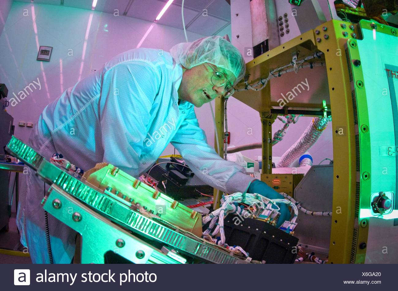 Martin Leahy performs voltage and continuity tests on a tactical satellite, or TacSat-3, at the Air Force Research Laboratory Stock Photo