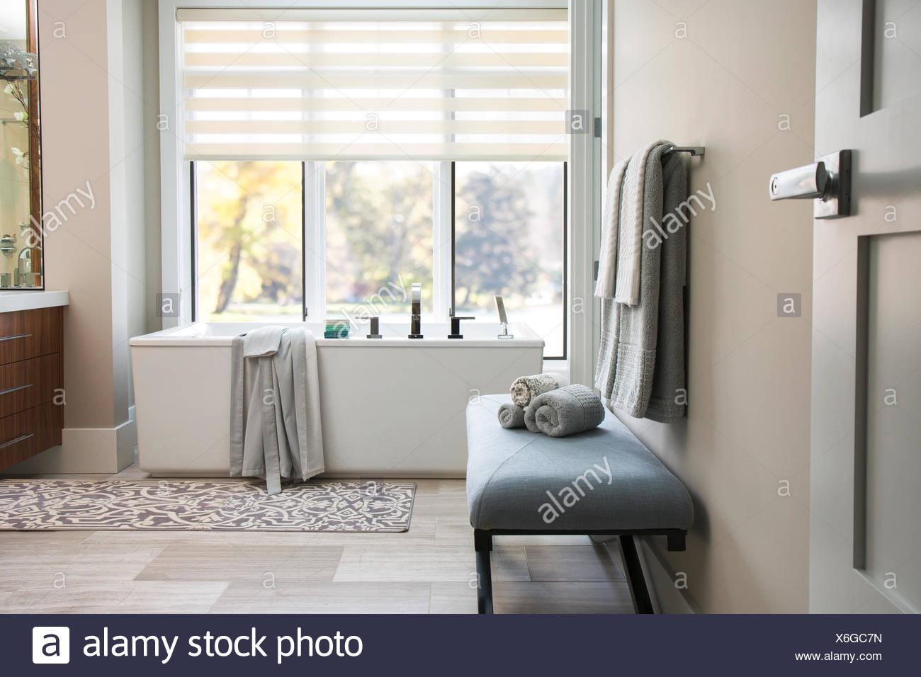 Modern bathtub in elegant bathroom - Stock Image