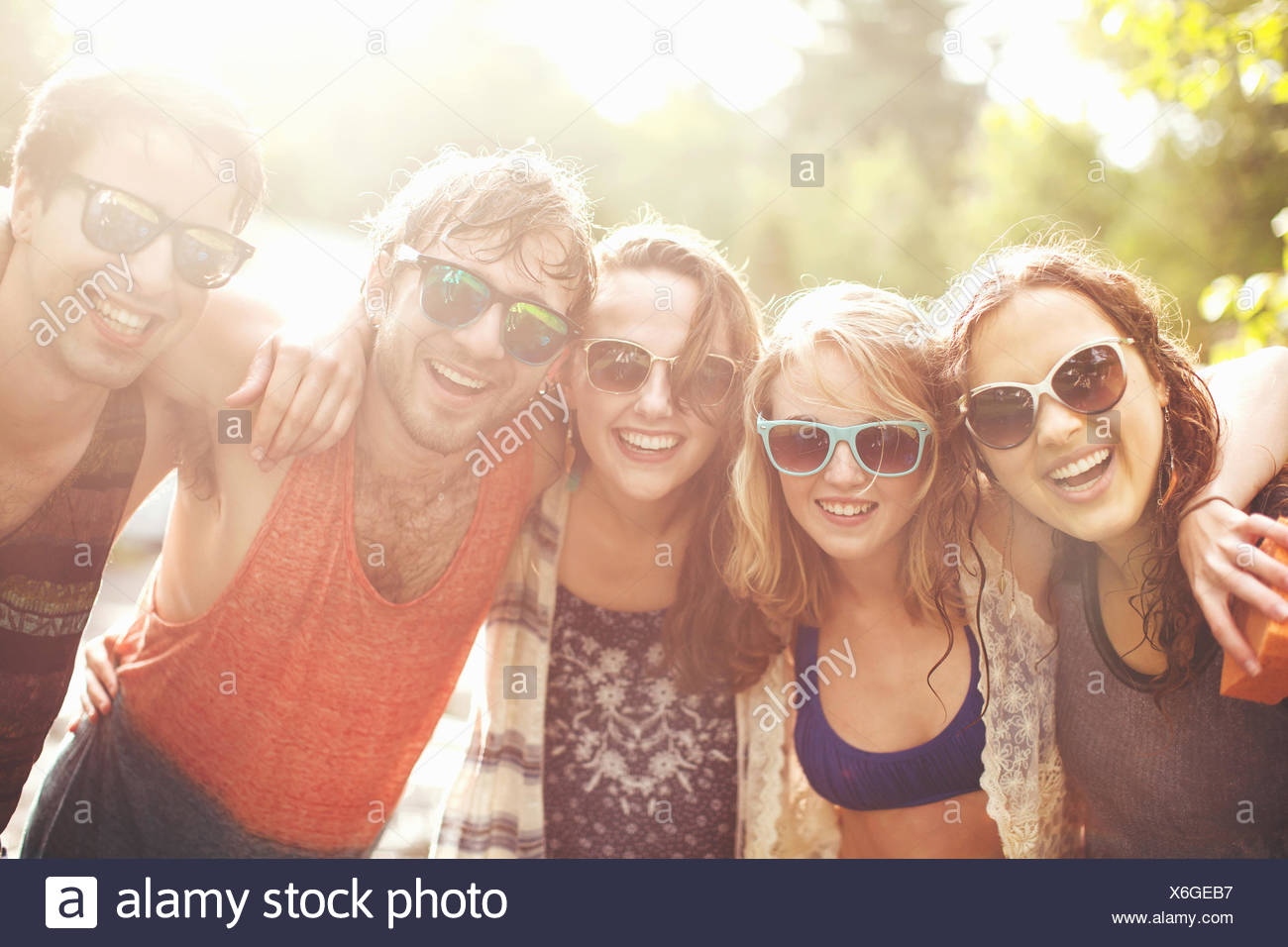 Five friends with arms around each other, portrait Stock Photo