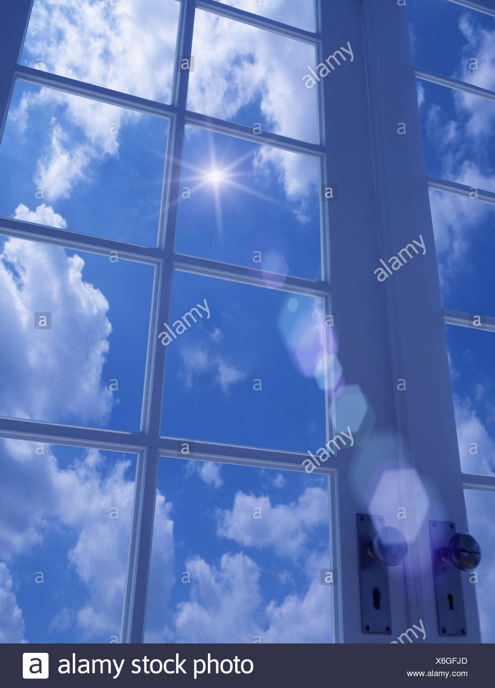 View of the sky from a doorframe - Stock Image