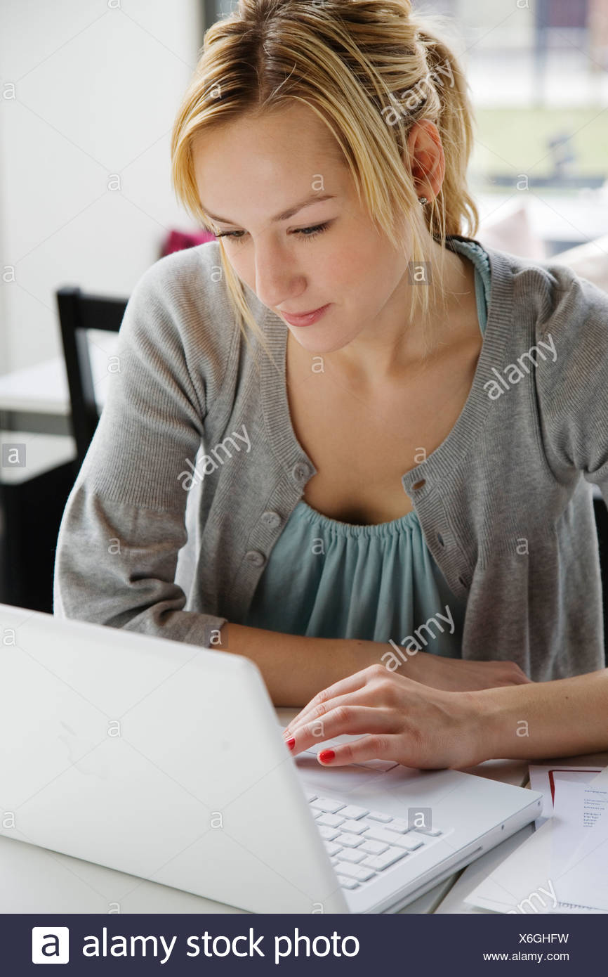 A woman using a laptop in a café Sweden. - Stock Image