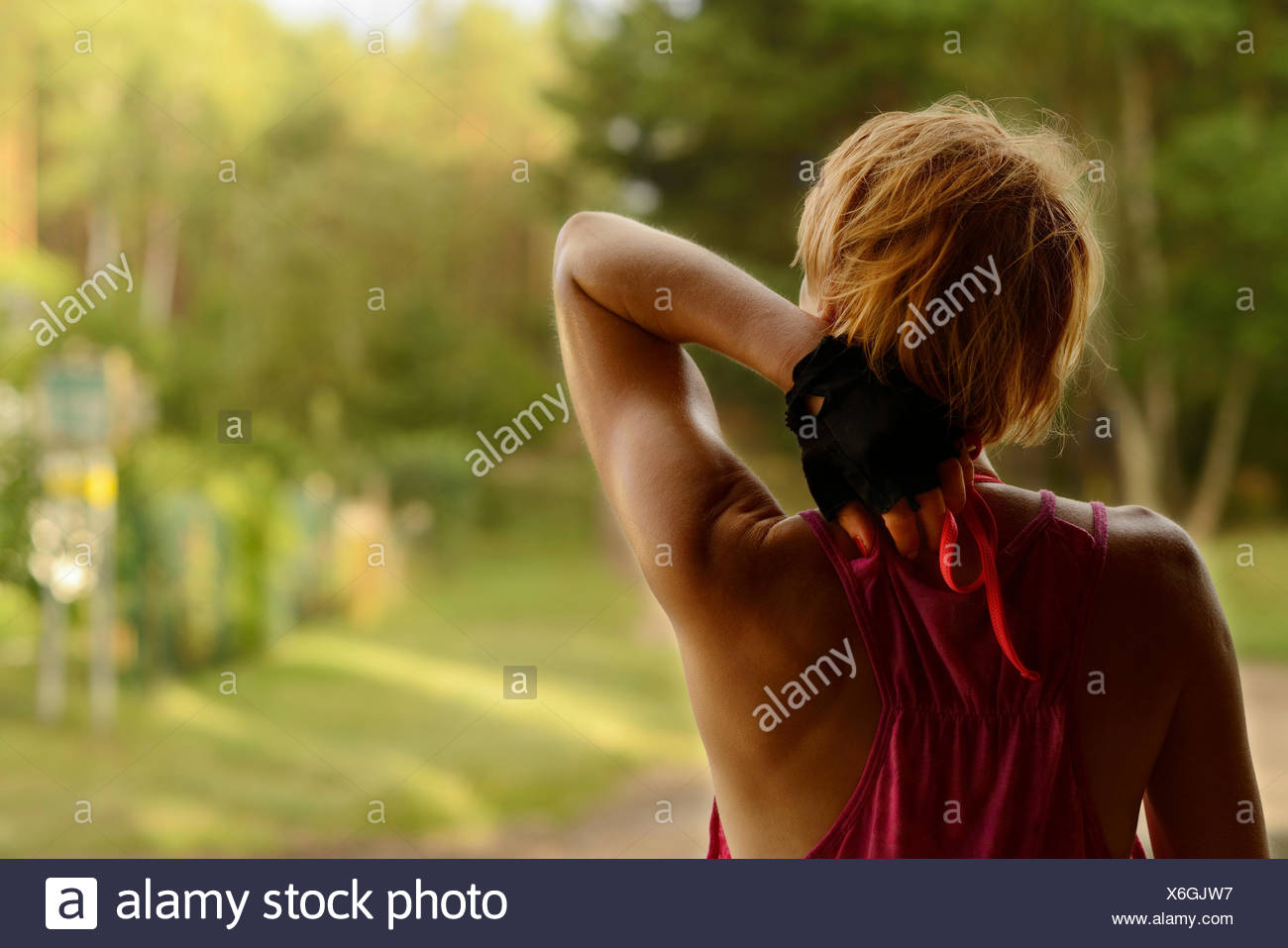 Young woman stretching outdoor. - Stock Image