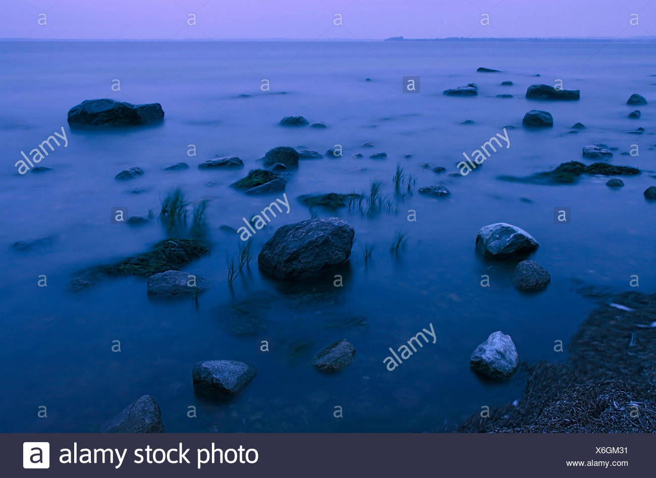 Blue hour on the beach of the Baltic Sea, long exposure, Poel island, Mecklenburg-Western Pomerania, Germany, Europe - Stock Image