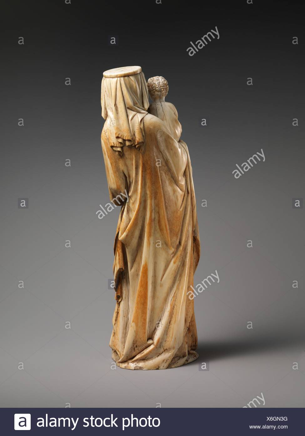 Virgin and Child. Date: ca. 1320-30; Culture: French; Medium: Ivory with traces of polychromy and gilding, (modern wooden base); Dimensions: without - Stock Image