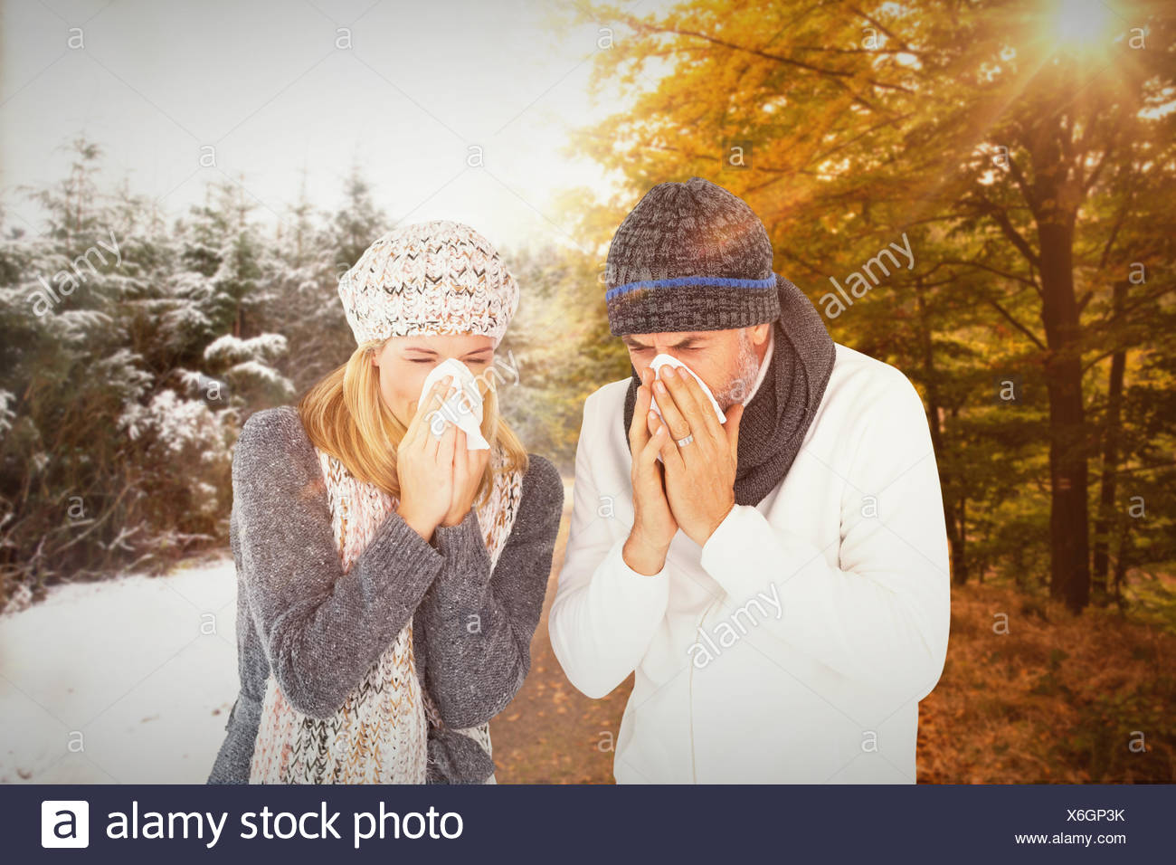 Composite image of couple sneezing in tissue Stock Photo