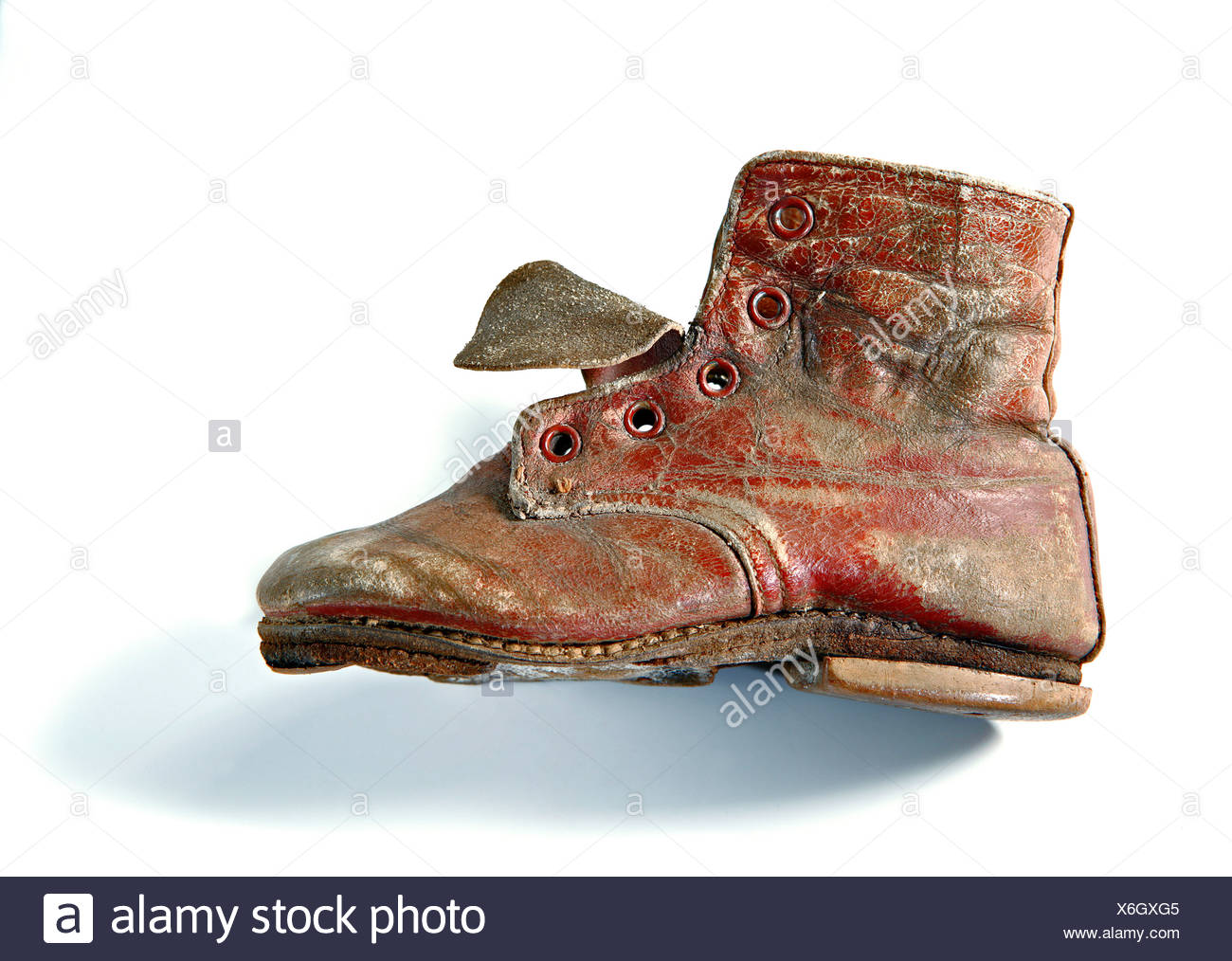 Worn-out children's shoe - Stock Image