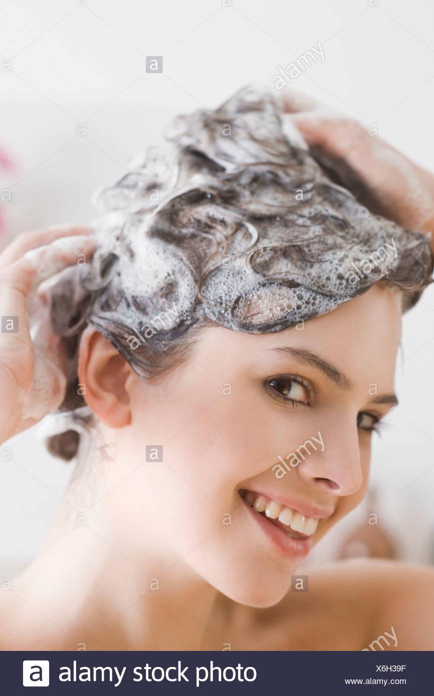 woman washing hair - Stock Image