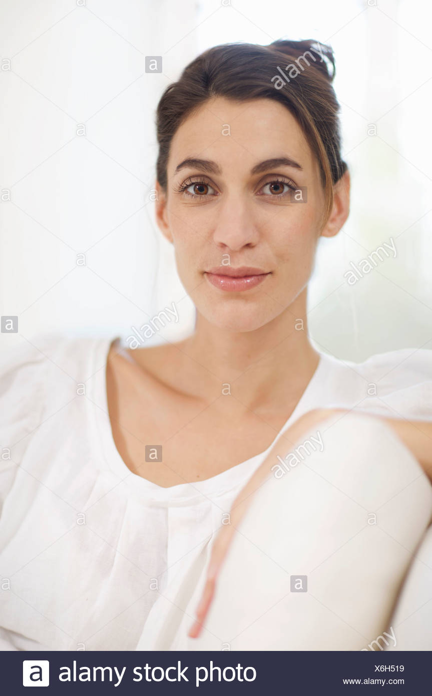 woman with striking eyes ebony faced - Stock Image