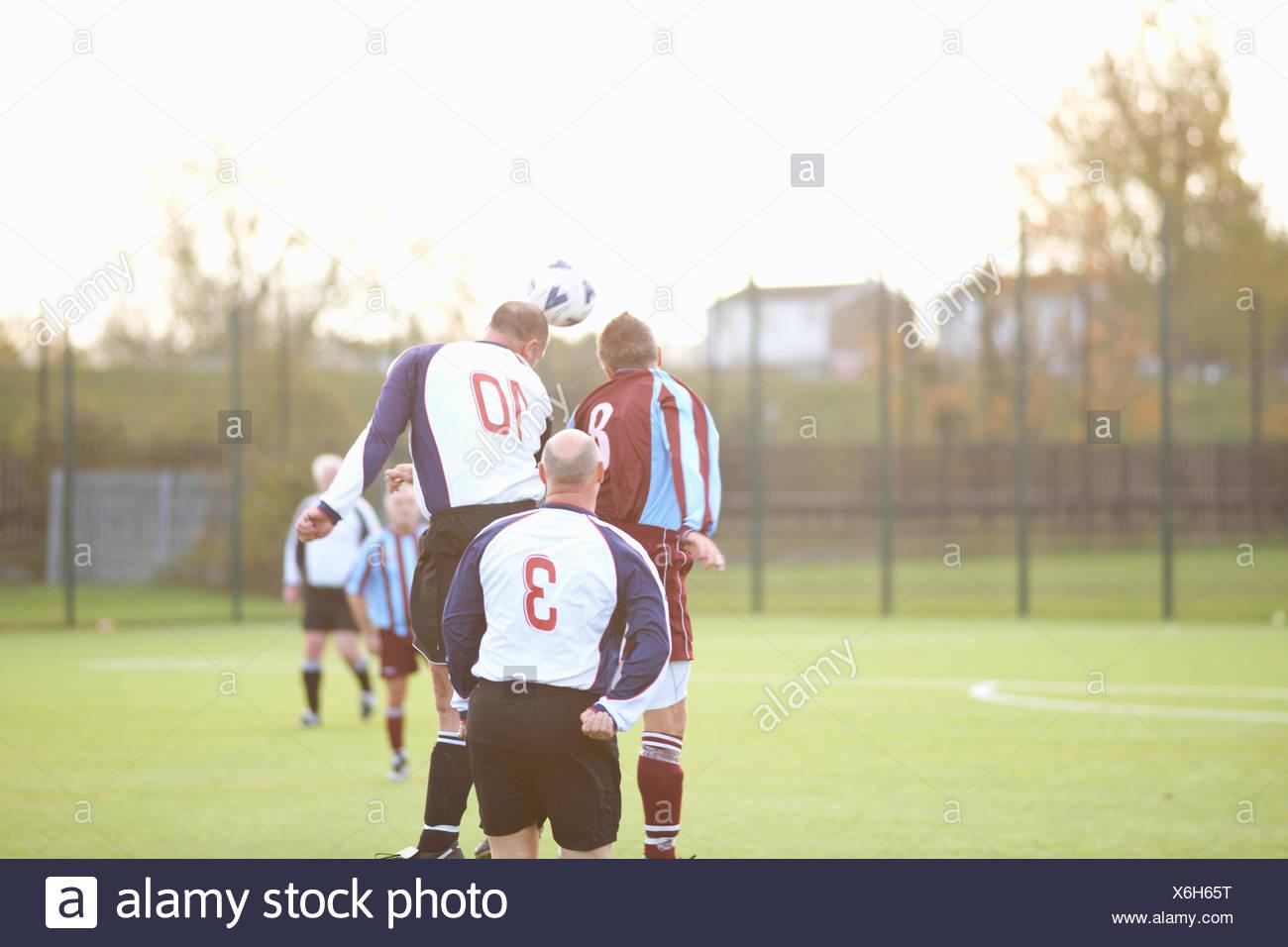 Football player heading ball - Stock Image