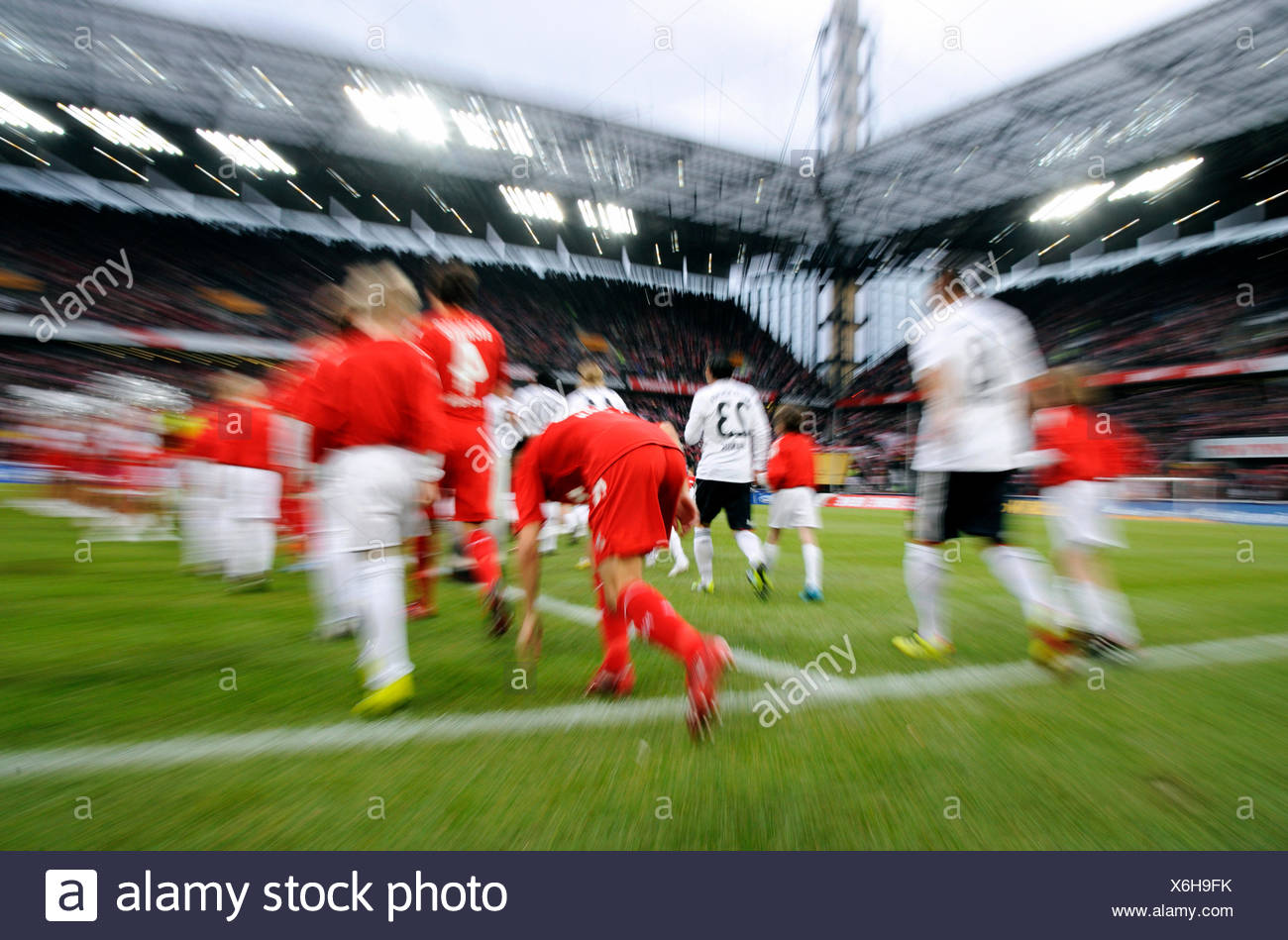 Teams entering the field, 1. FC Koeln - FC Bavaria Munich 3:2, Bundesliga, Federal League, 2010-2011 season, 21st round Stock Photo