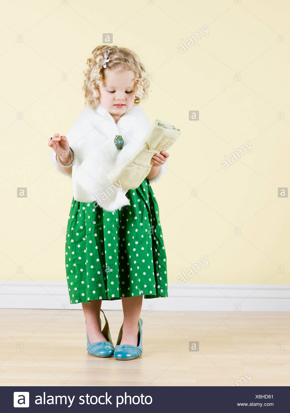 little girl playing dress up - Stock Image