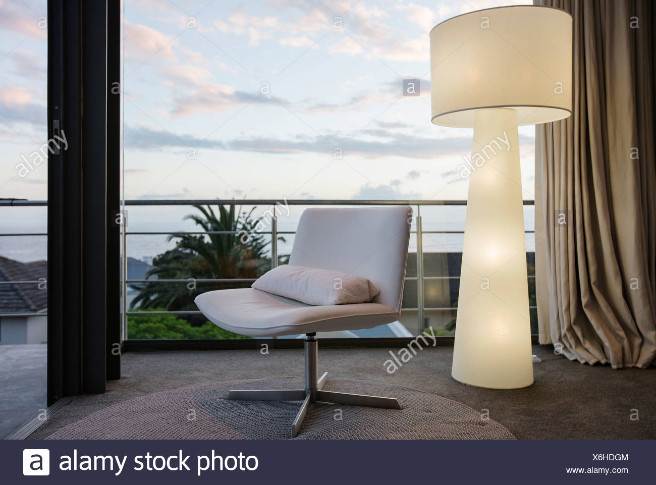 Modern Floor Lamp And Chair In Living Room Corner Stock