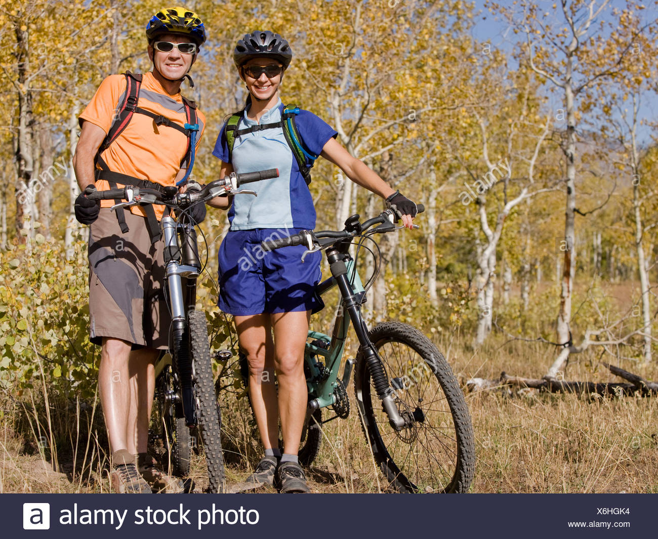 Male and female mountain bikers. - Stock Image