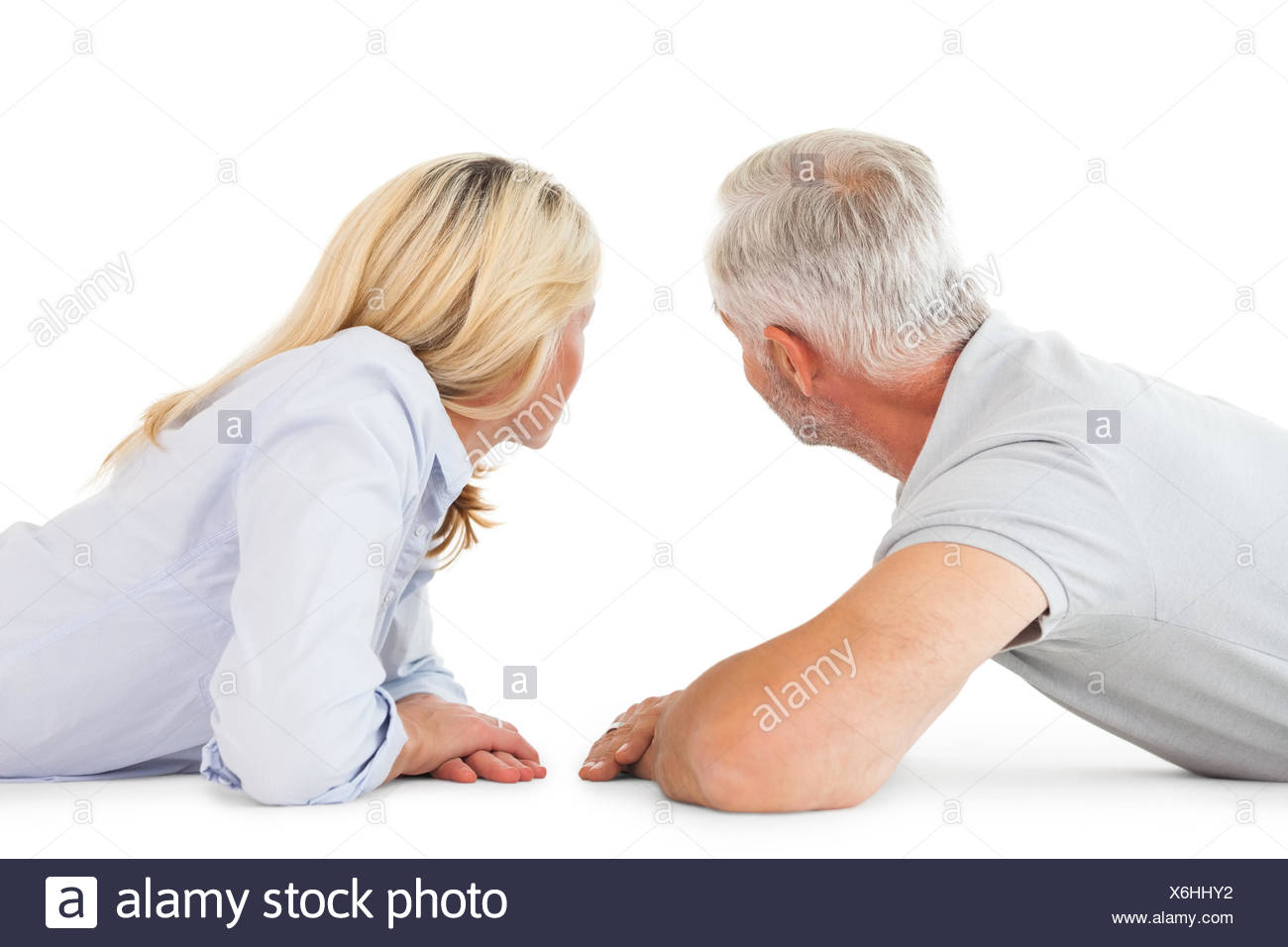 Happy couple lying and looking - Stock Image