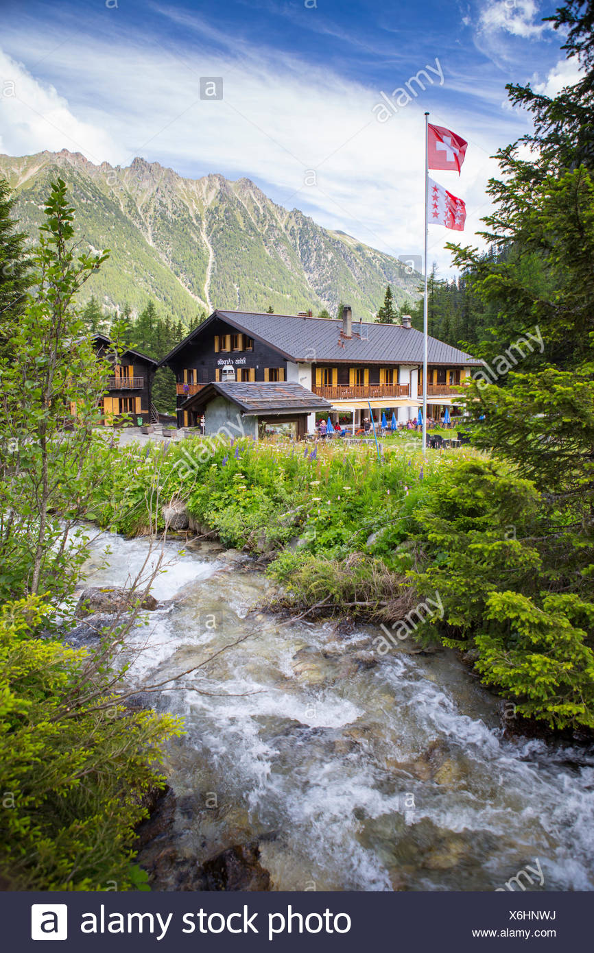 The Relais d'Arpette, a mountain hut near Swiss Champex, on the Tour du Mont Blanc, a classic multi day hike that goes through France, Italy and Switzerland. - Stock Image