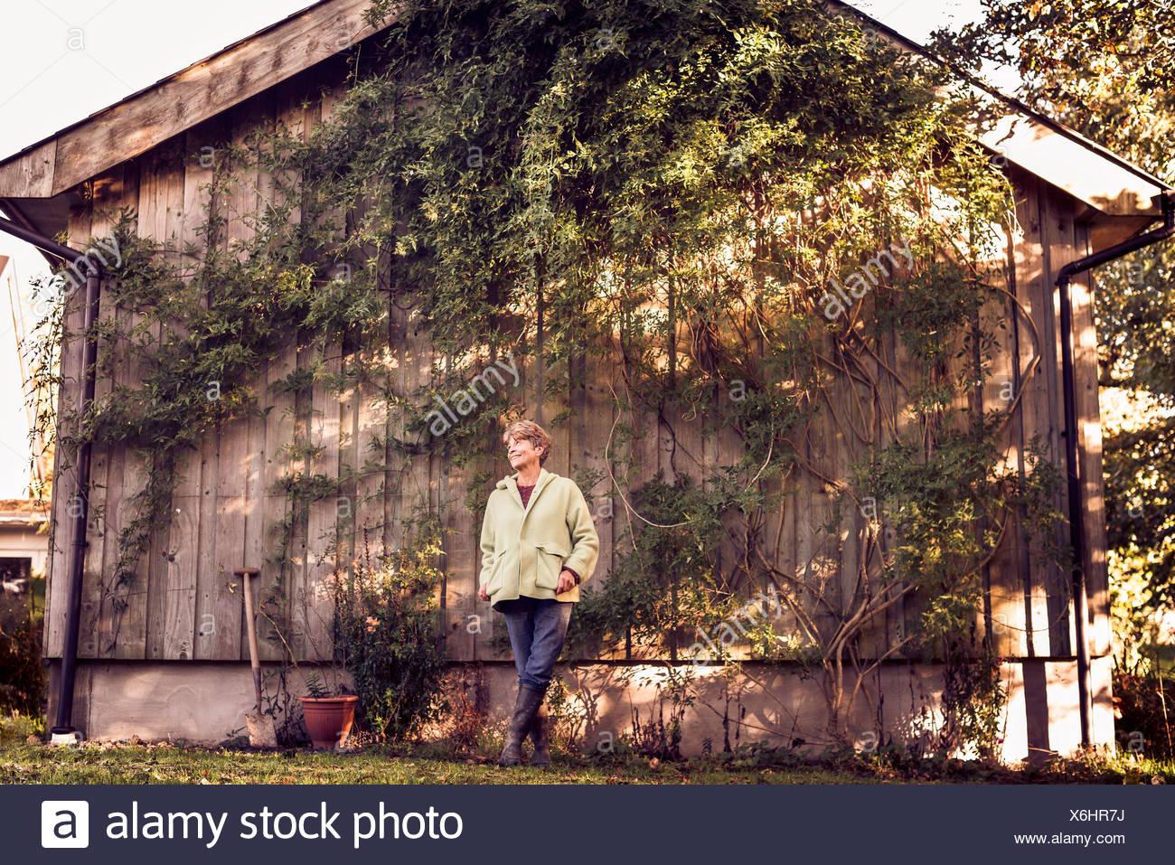Portrait of happy mature woman in garden Stock Photo