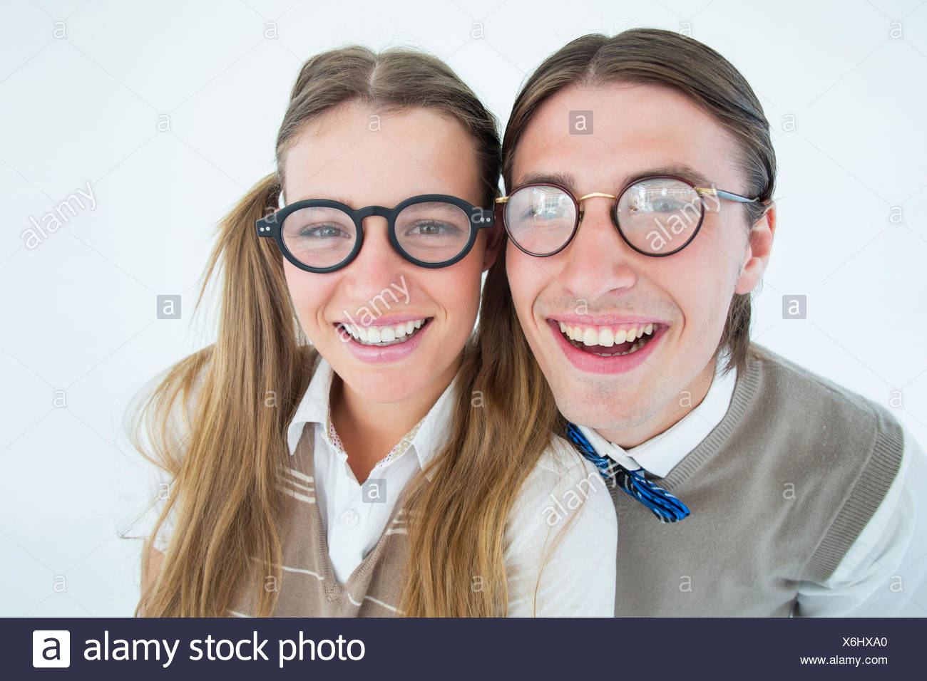 Geeky hipsters smiling at camera - Stock Image