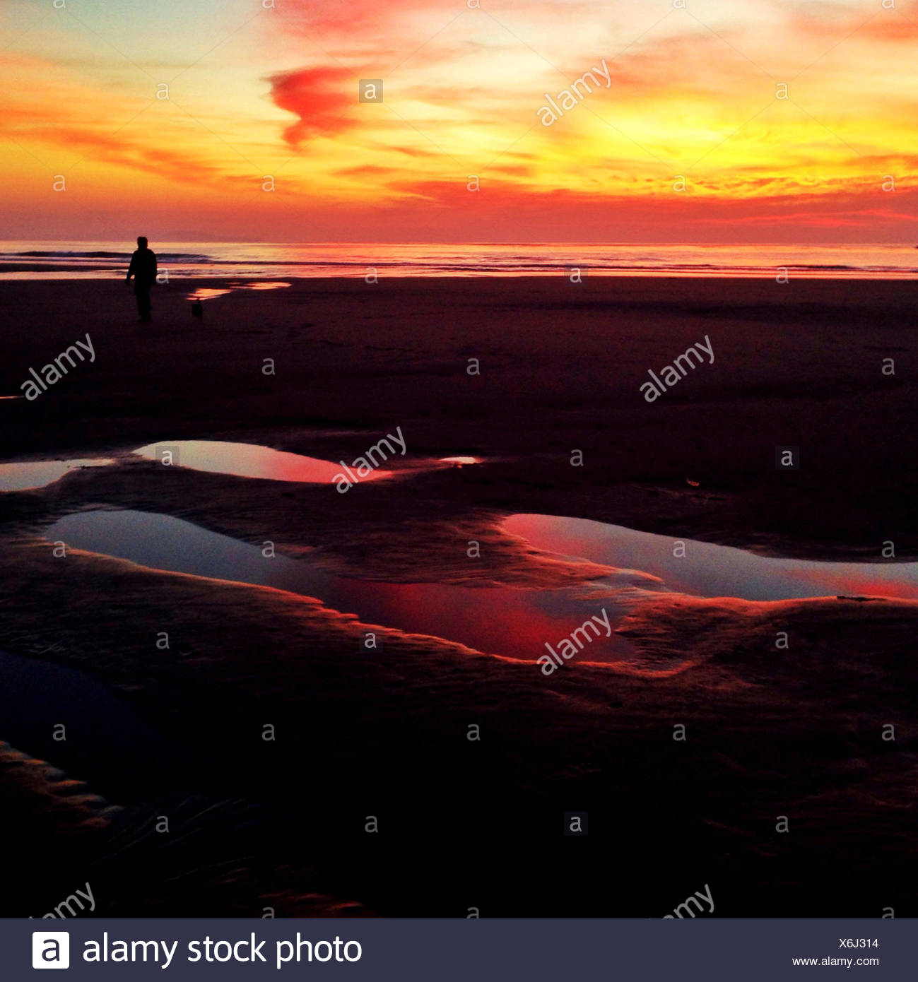 Scenic seascape at sunset - Stock Image