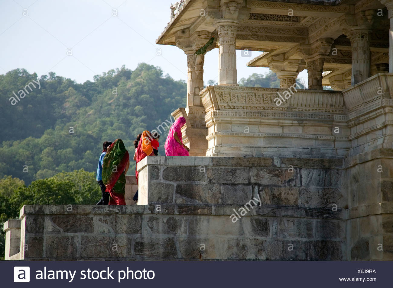 4387f2cbf2 Indian family in traditional dress entering Ranakpur temple in Rajasthan.