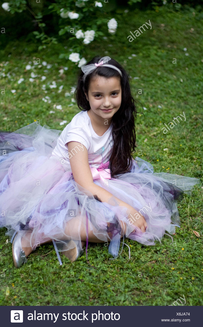 826be62b4 Girl dressed in a tutu sitting on the grass Stock Photo: 279457000 ...