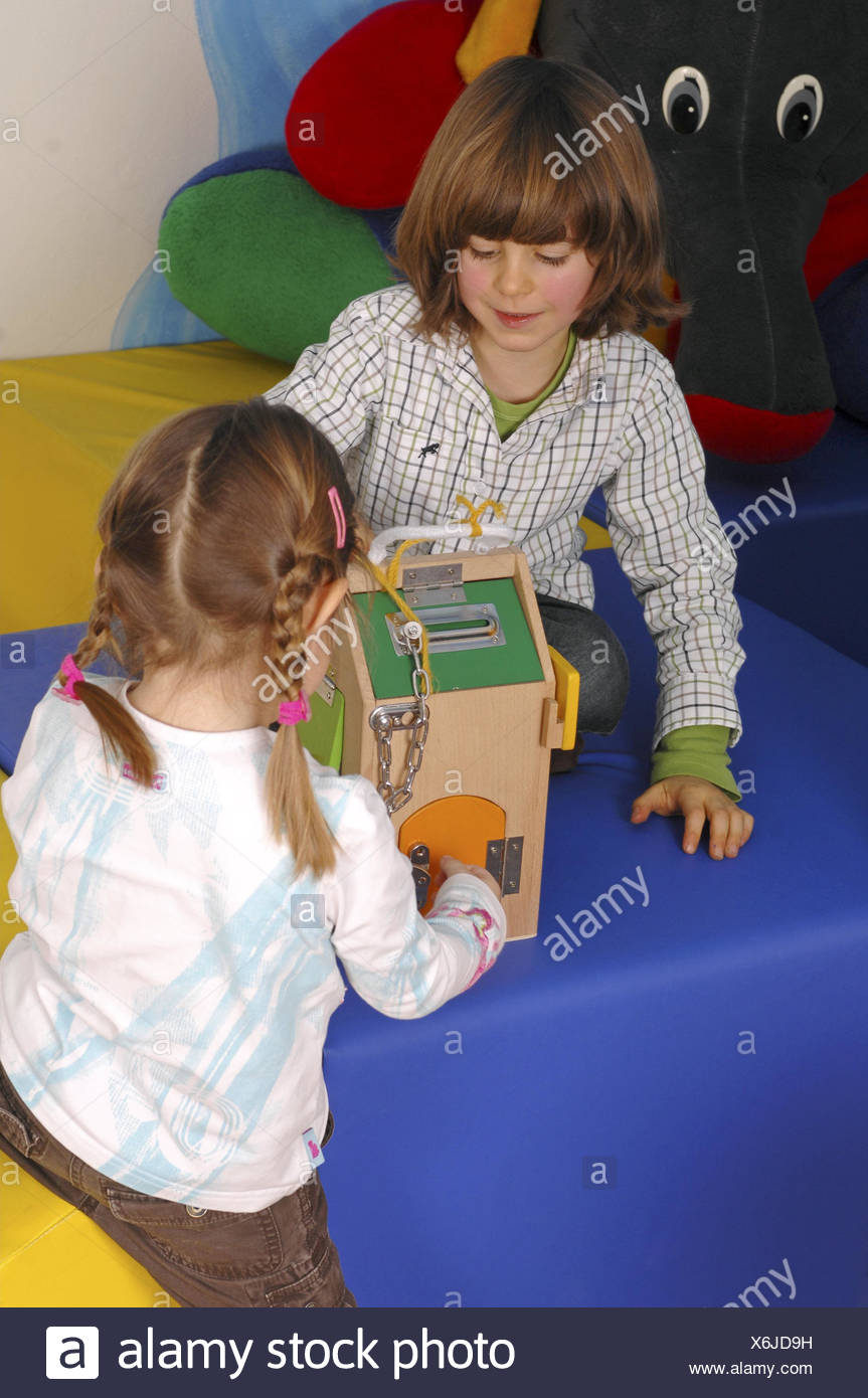 Children, two, play, learning game, kindergarten, person, girl, boy, wooden house, wooden toys, learning toys, toys, learn, playfully, kindergarten friends, educationally, Stock Photo