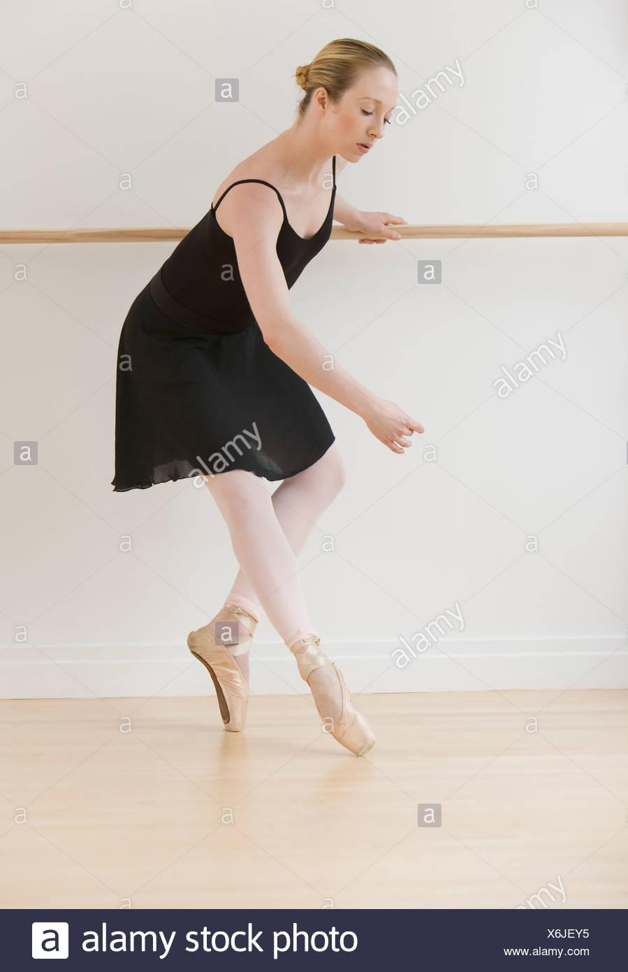 Female ballet dancer in dance studio Stock Photo