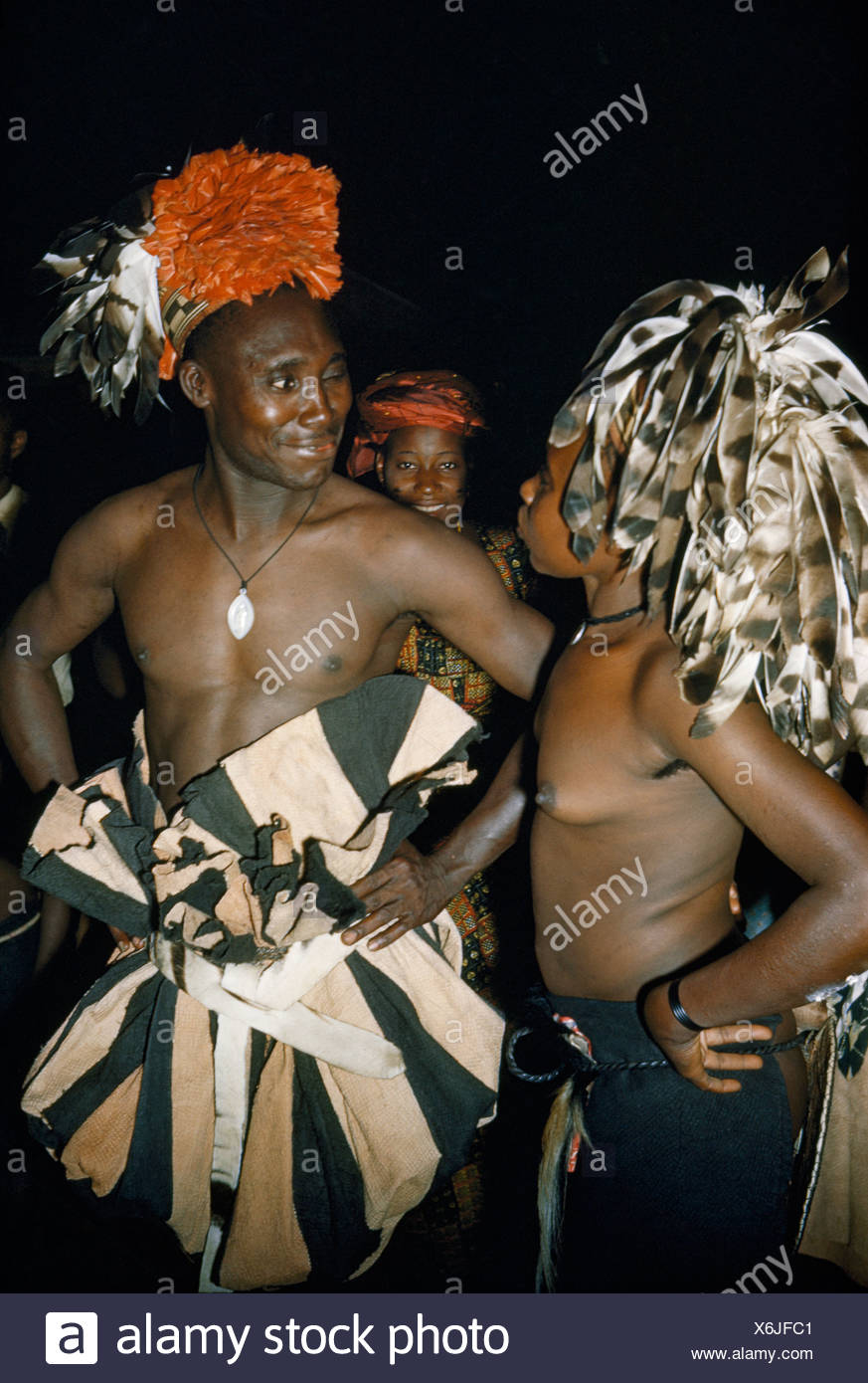 A Mangbettu chief winks at his sister before a nighttime dance. - Stock Image