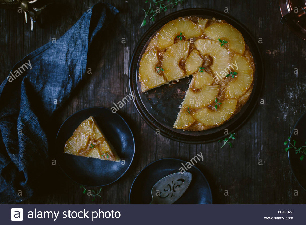 Dark food photography Pineapple Upside Down Cake Upside Down cake cake dessert nobody top view vintage - Stock Image