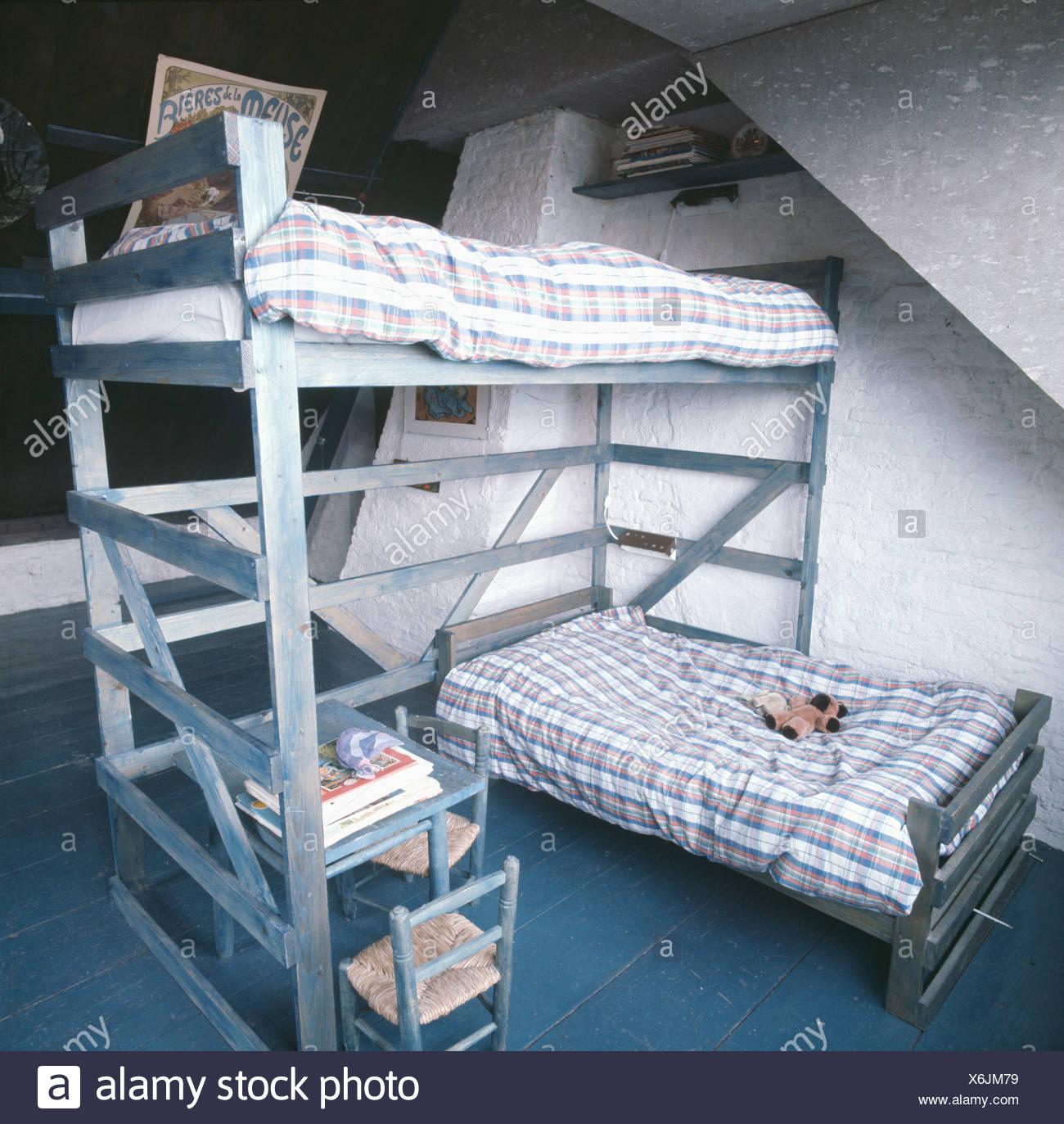 Checked bedlinen on bunk beds in sixties childrens bedroom ...