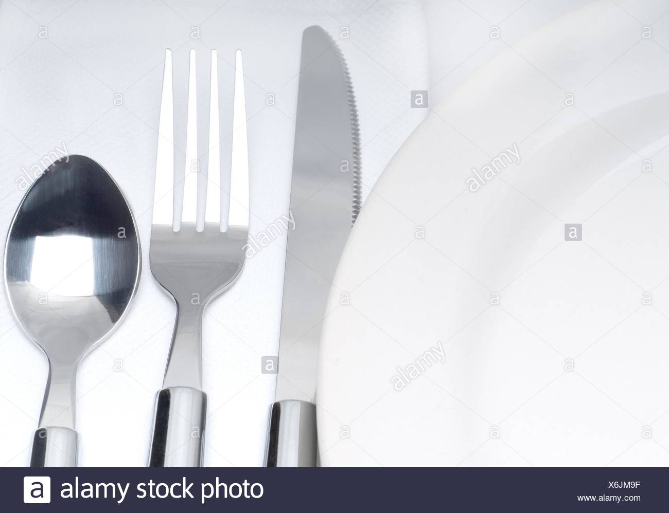 close up of a cutlery set on a table with napkin and dish. - Stock & Empty Plate Cutlery Table Cloth Stock Photos u0026 Empty Plate Cutlery ...