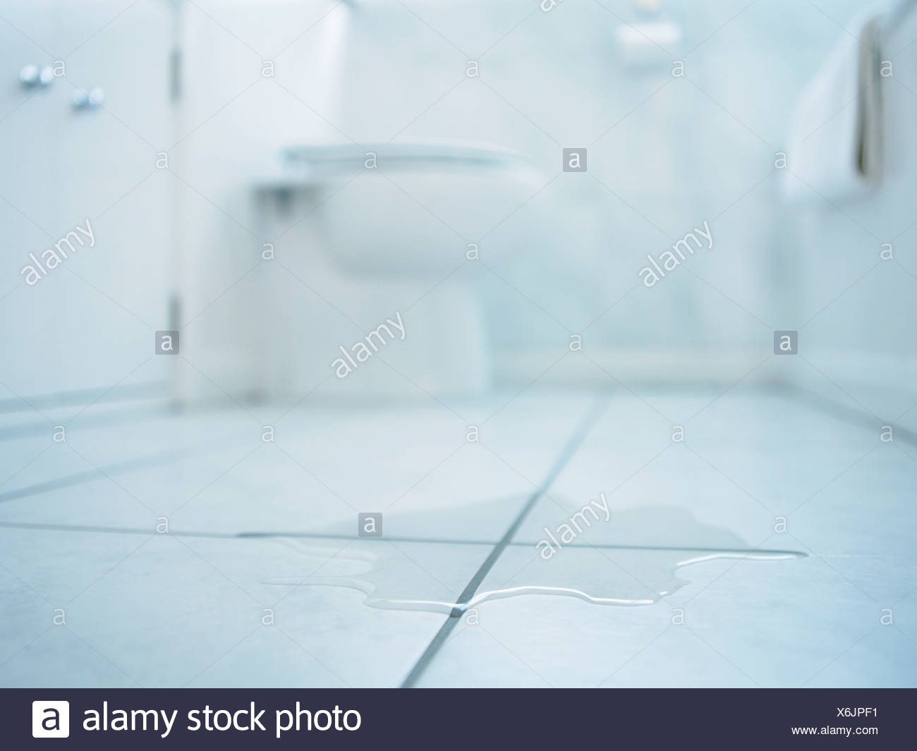 Close up of water spill in bathroom - Stock Image