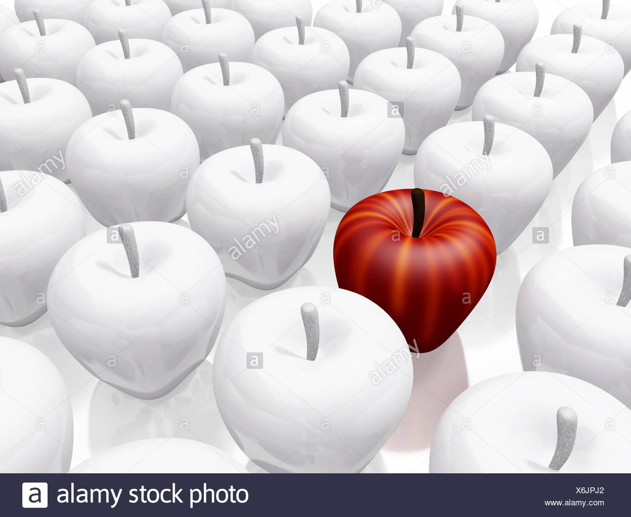 One Red Apple Amidst White Ceramic Apples Stock Photo