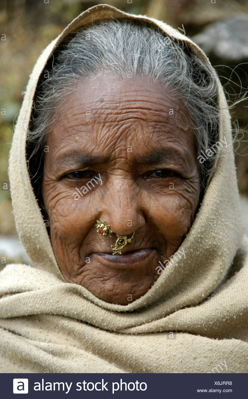 Portrait Of An Old Lady With A Pierced Nose In The Hood Near Pokhara