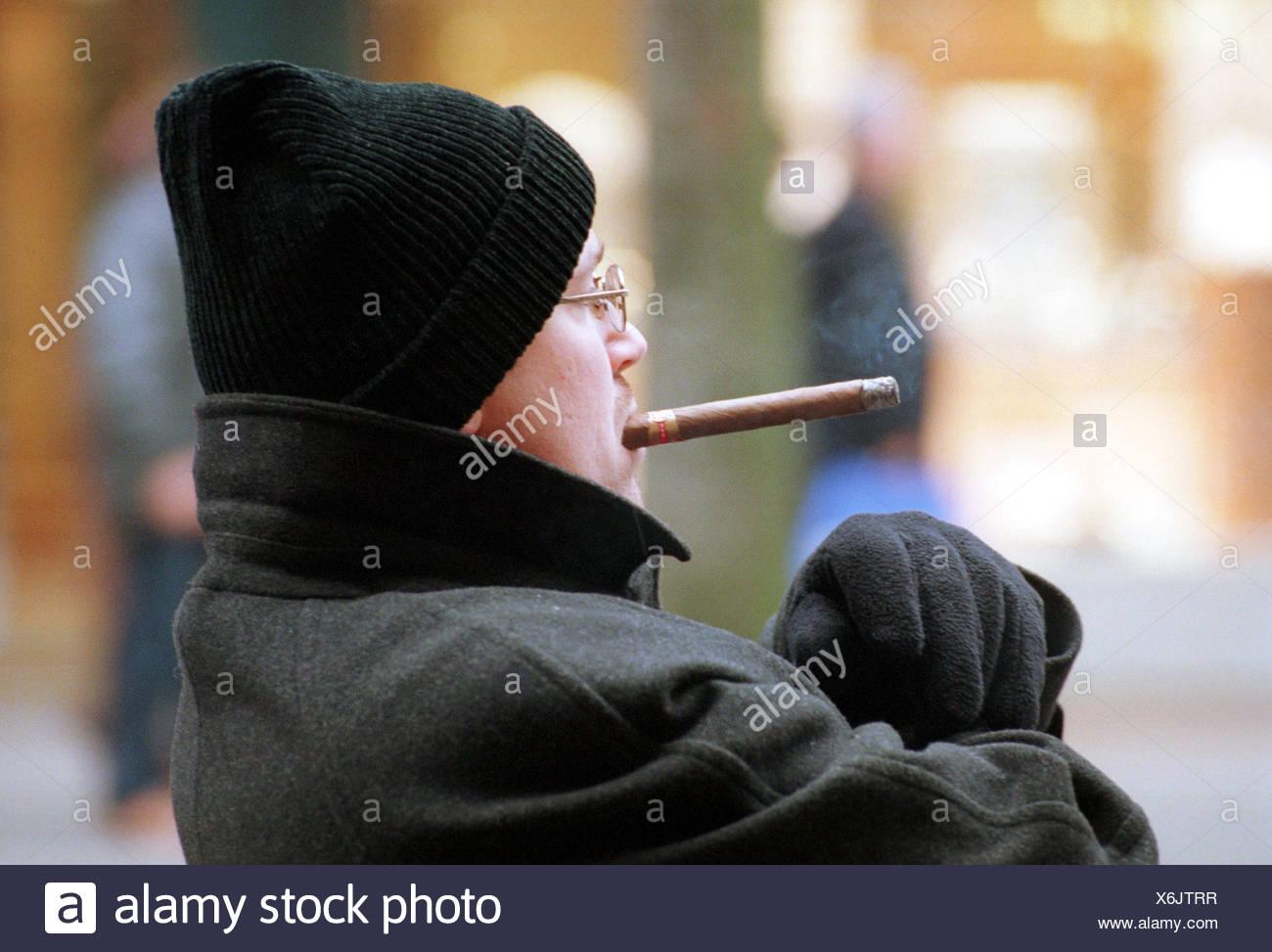 Man with cigar in the Zuercher Bahnhofstrasse, Switzerland - Stock Image