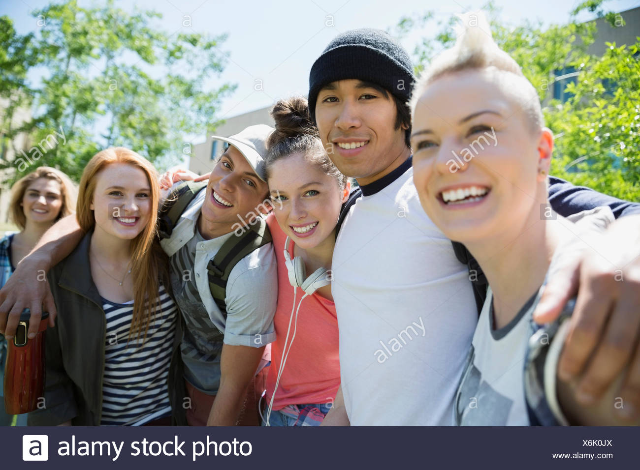 Portrait confident college students in a row - Stock Image