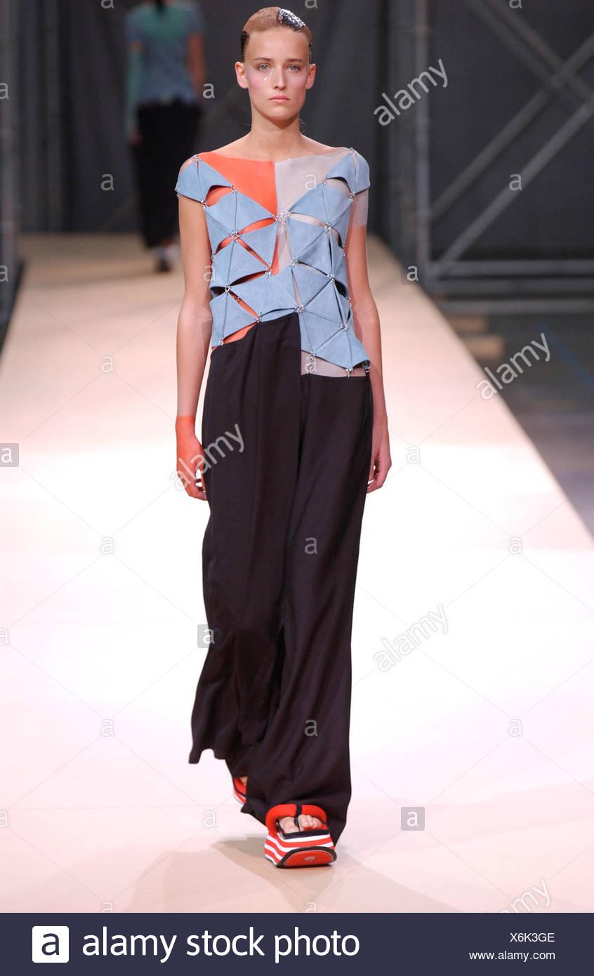 99b9f5bd5b8 Yohji Yamamoto Haute Couture Paris autumn winter fashion show Model  brunette hair off face plastic ornaments