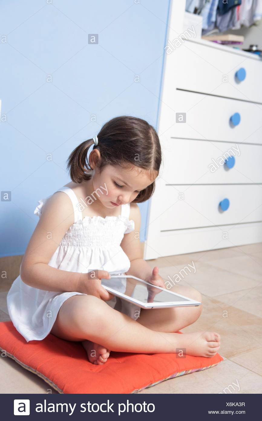 Cute Little Girl Sitting Barefoot Stock Photos & Cute
