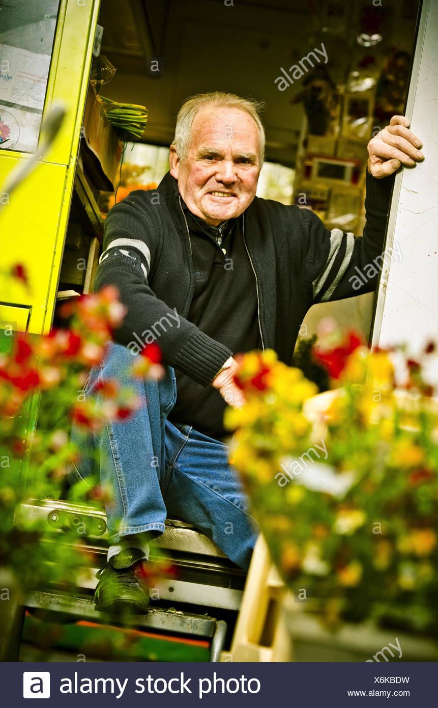 Germany, Hamburg, flower market, flower stall, owner, Stock Photo