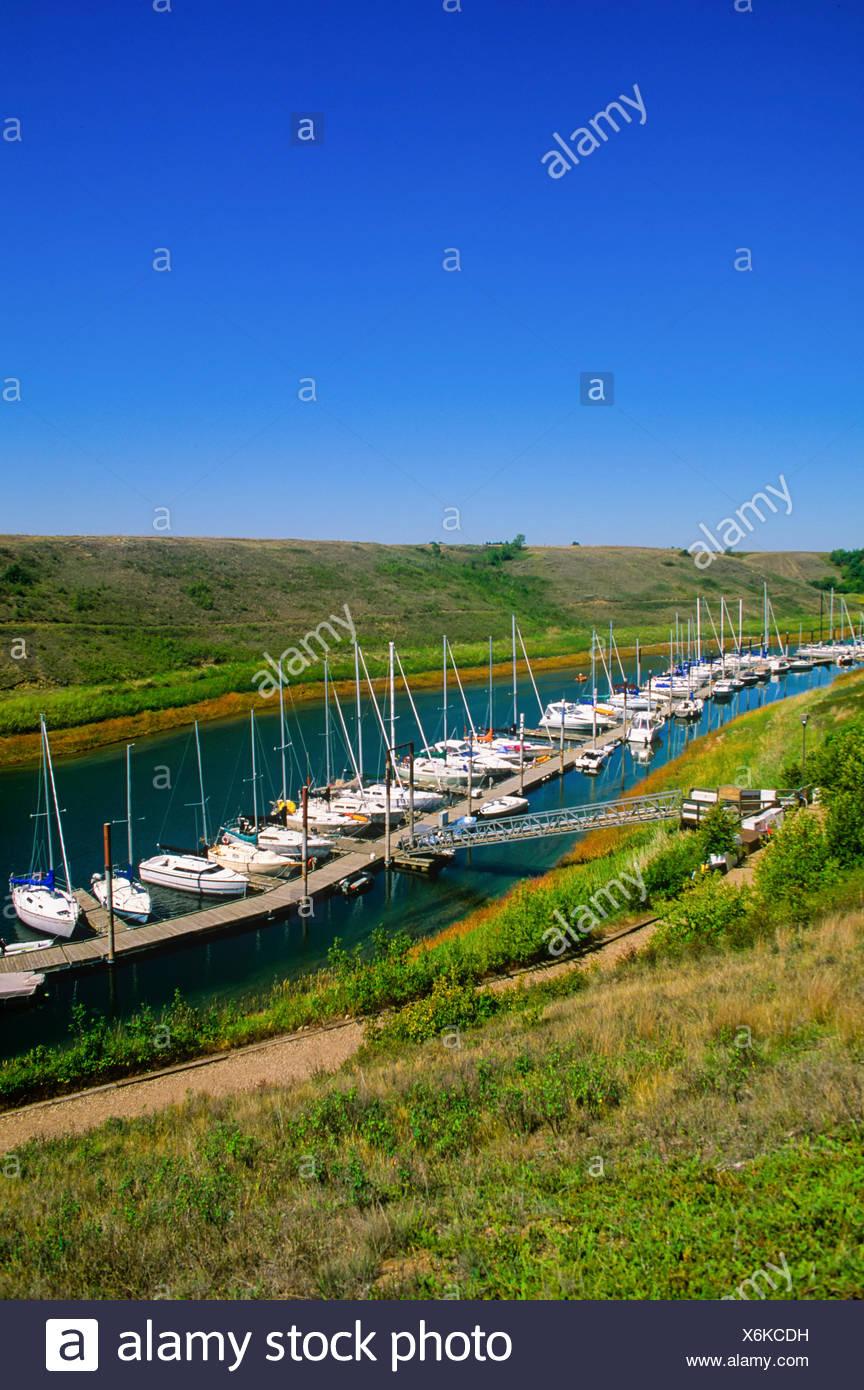 pleasure boats tied up at Elbow Marina, Lake Diefenbaker, Saskatchewan, Canada - Stock Image