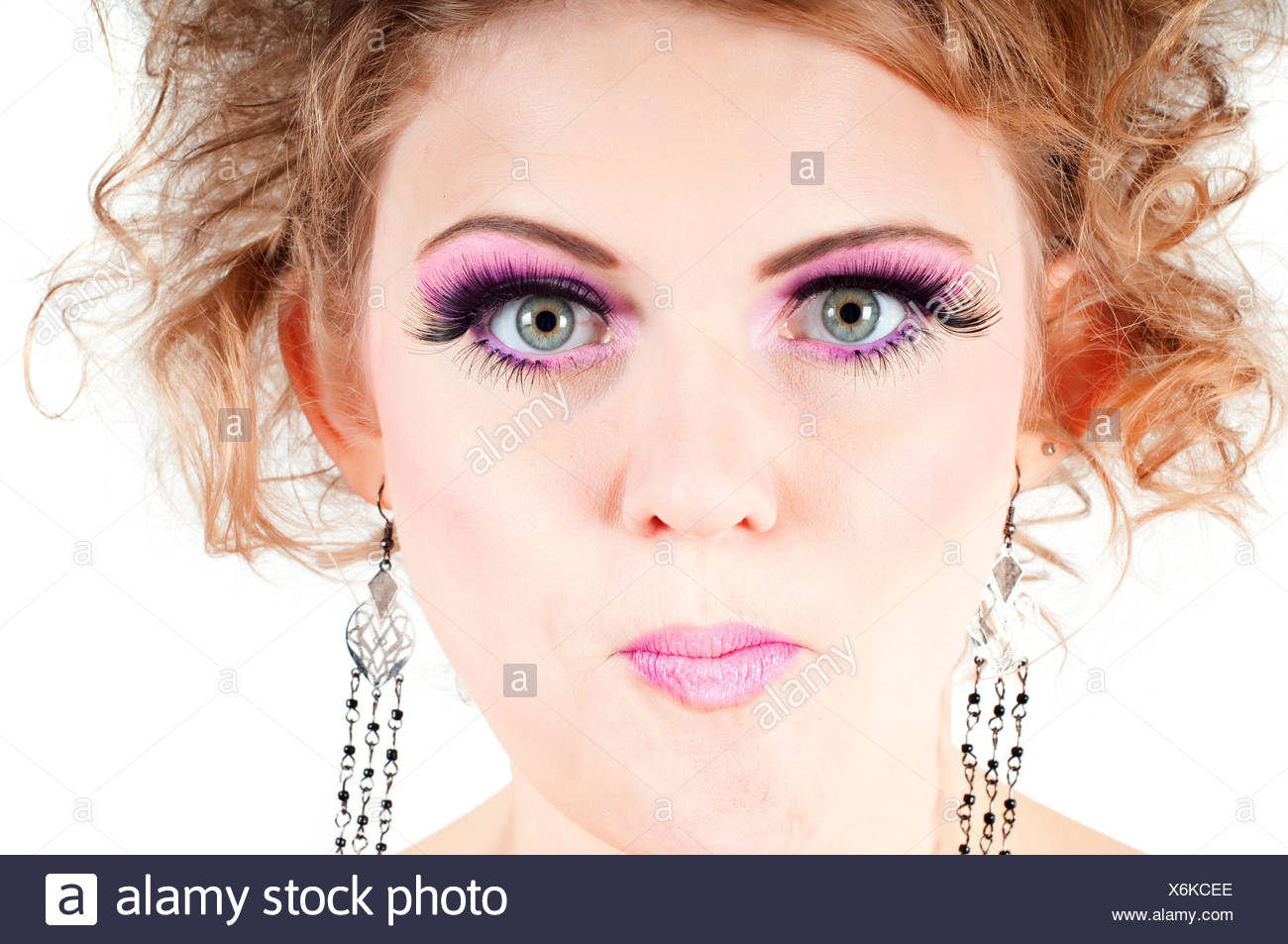 Blonde with fancy make-up grimacing Stock Photo