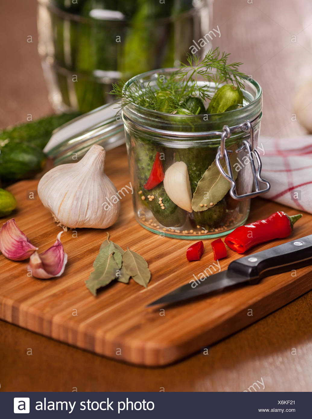 Pickled cucumbers on cutting board. Debica, Poland - Stock Image