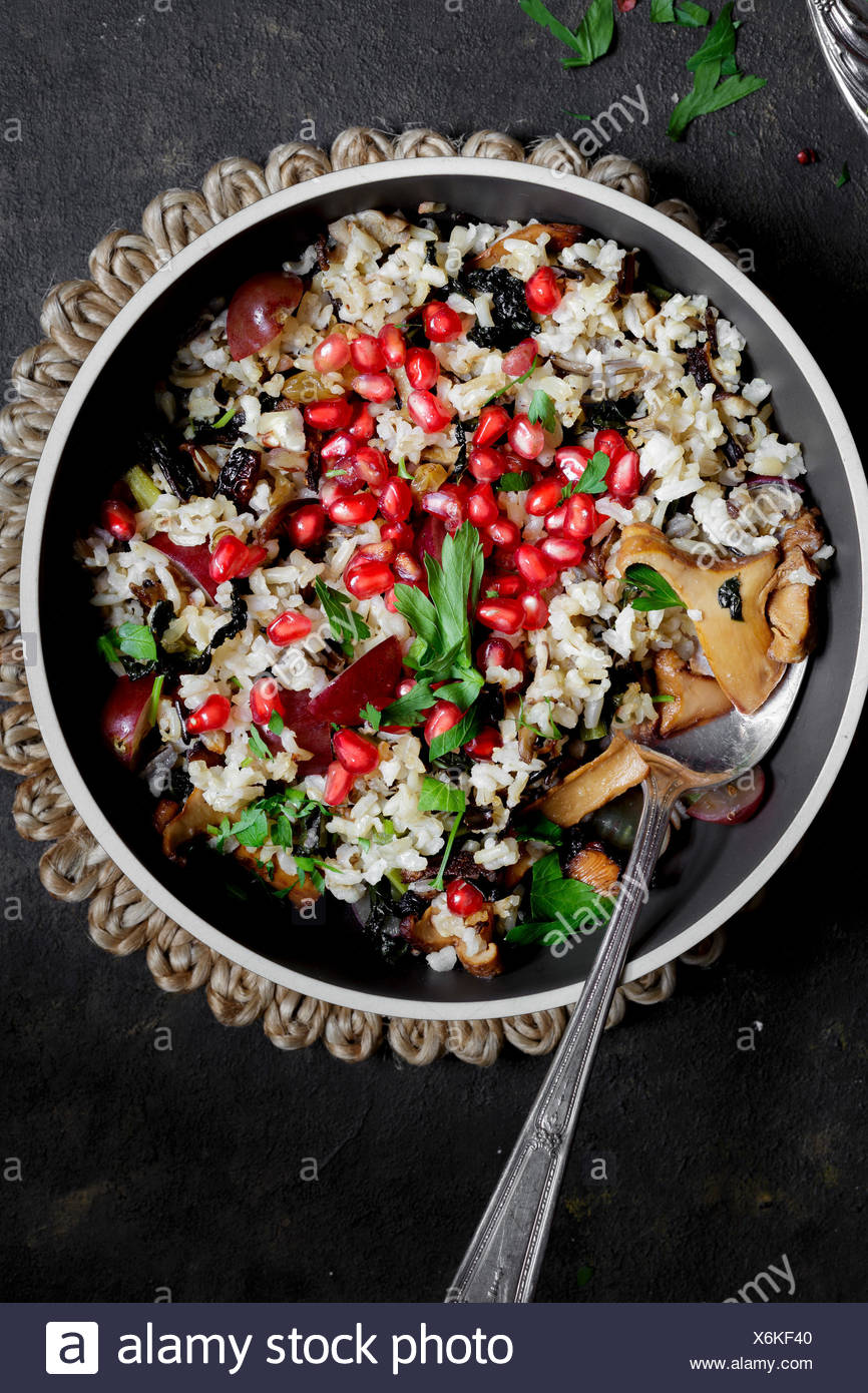 Rice, pomegranate seeds and mushrooms savoury side - Stock Image